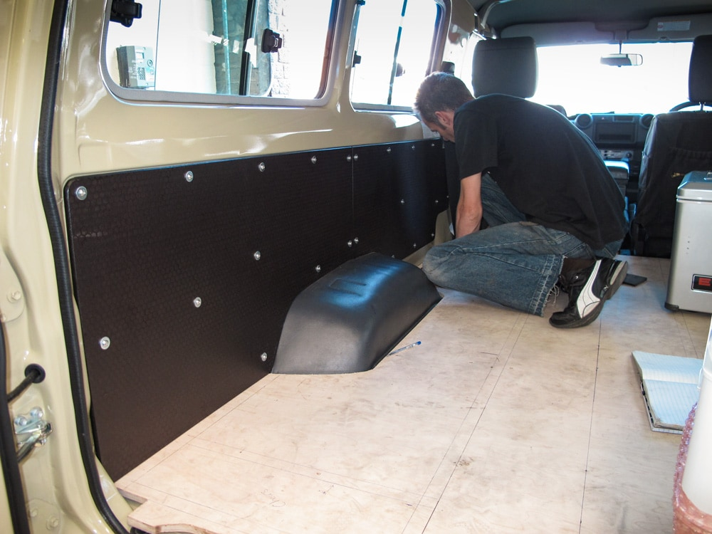 Installing the floor and interior during camper conversion of a Land Cruiser 78 Troopy