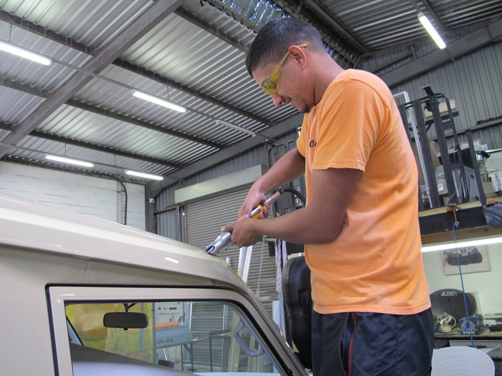 Alu-Cab installing pop-top tent on a Land Cruiser Troopy