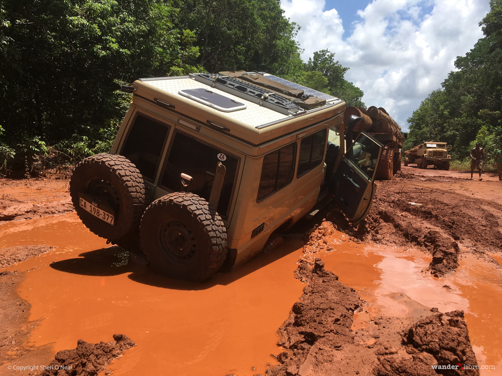 A photo of Maggie, our Land Cruiser Troopy, stuck in deep mud along the road from Georgetown to Lethem, Guyana.